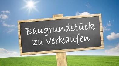 Grundstück verkaufen München - Schild mit Bauland zu verkaufen